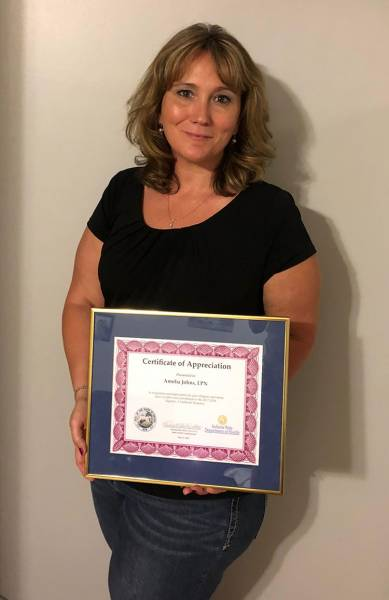 Clark County Health Department nurse Amelia Johns received an award from the Indiana State Health Commissioner for her work fighting a hepatitis A outbreak in the state.