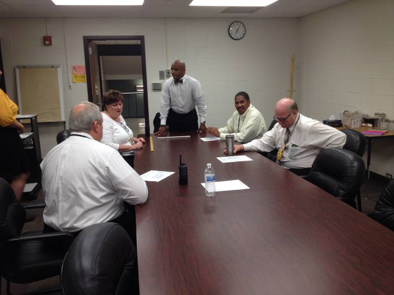 Arlington Principal Stan Law makes a few last comments to other administrators minutes before Arlington High School opens for class on the first day of the 2015-16 school year, Monday, August 3, 2015. | By Eric Weddle/WFYI News