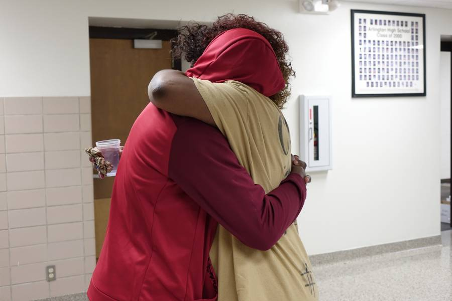 Keisha Ross, mother of one of Jaylan Murrays best friends, hugs her son at Arlington High School on February 4, 2016. | By Eric Weddle