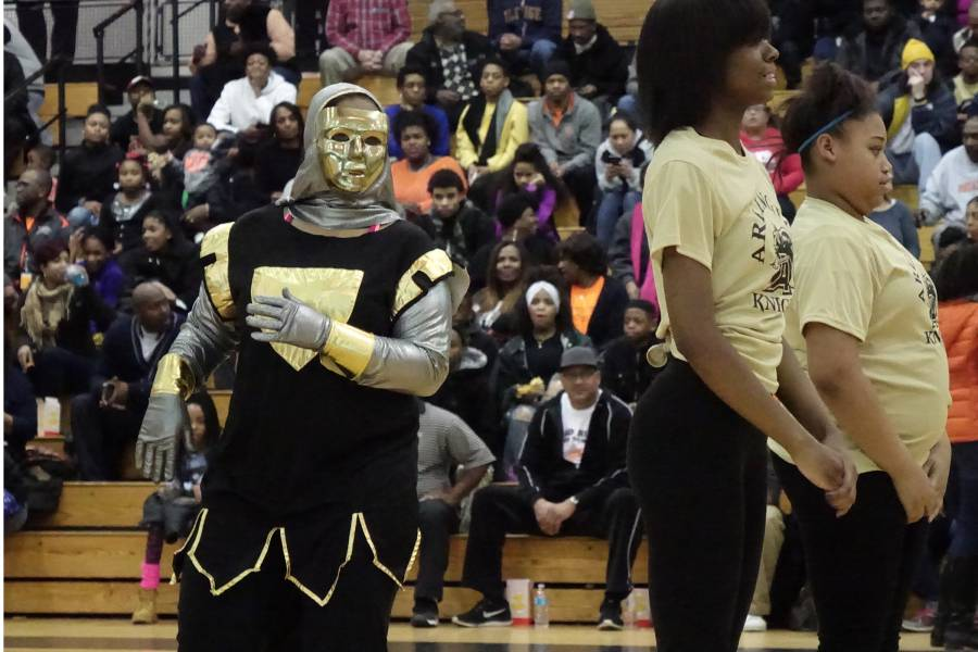 Arlington senior Alyssa dances as the school's mascot, the Golden Knight, during a March 2016 basketball game.