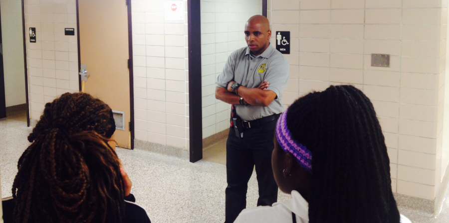 Principal Stan Law questions a large group of female students who crossed his path on the first floor of Arlington on Sept 4, 2015. The students were not in class and Law didn't believe the excuses they gave. | By Eric Weddle/WFYI News