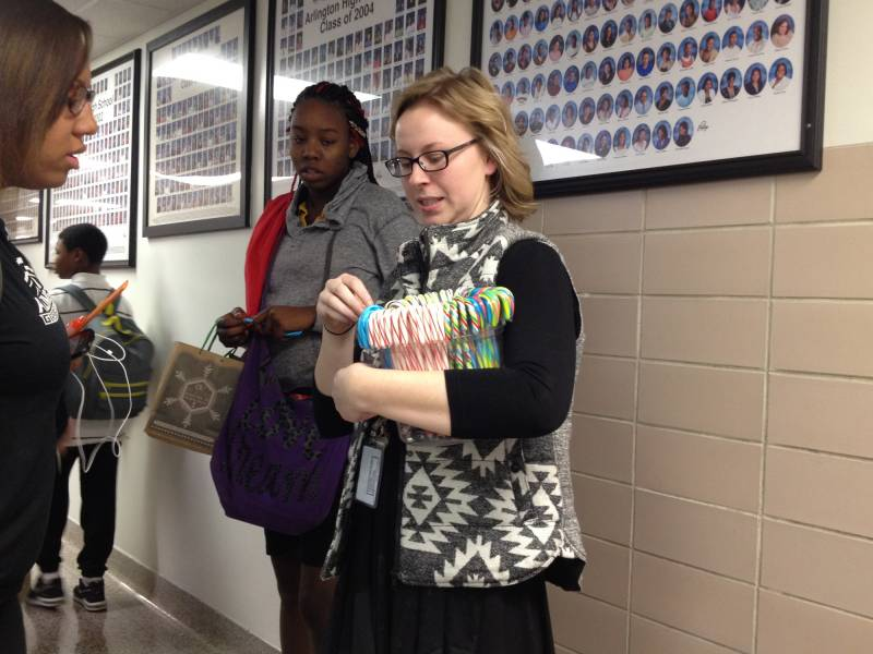 Chemistry teacher Lauren Martin hands out candy canes on the last day of the 2015 school year -- and her last day at Arlington. | By Eric Weddle/WFYI News