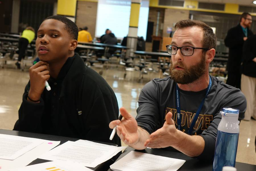 Freshman student Keiveion Anderson and teacher Joe Zwiebel talk with Irvington residents about the changes at Howe during a meeting about the future of the school on Tuesday, November 13, 2018. | By Eric Weddle/WFYI News