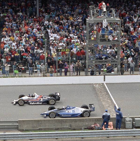 FILE - In this May 24, 1992, file photo, Al Unser Jr., top, of Albuquerque, N.M., wins the Indianapolis 500 by less than a car length ahead of Scott Goodyear, of Canada, at Indianapolis Motor Speedway in Indianapolis.