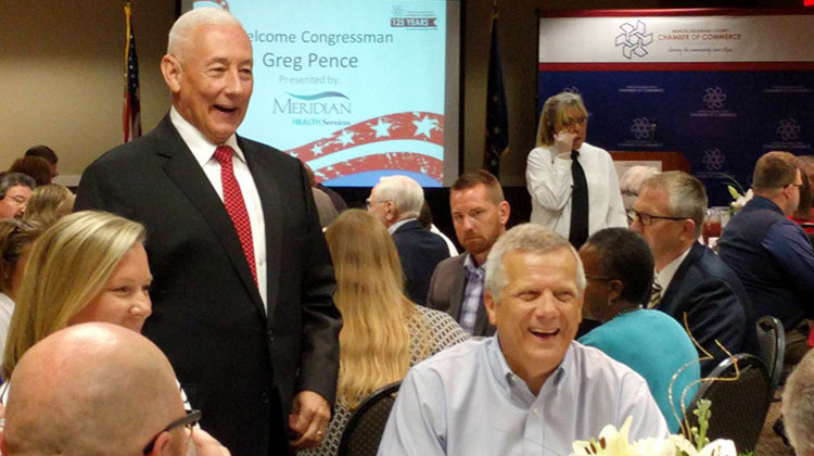 U.S. Rep. Greg Pence (R-6th District), standing, talks with constituents at a Chamber of Commerce lunch in Muncie. - Stephanie Wiechmann