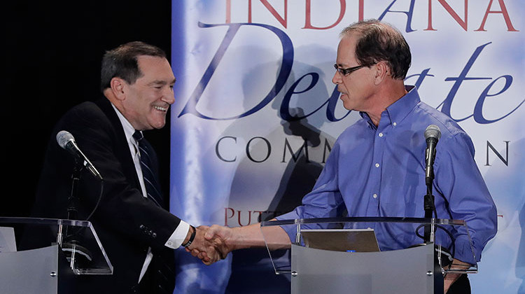 In this Oct. 8, 2018 photo, Sen. Joe Donnelly, D-Ind., left, shakes hands with Republican former state Rep. Mike Braun following a U.S. Senate Debate in Westville, Ind. Libertarian Lucy Brenton also participated in the debate. - AP Photo/Darron Cummings, Pool