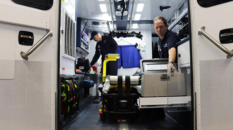 Paramedics Scott Widener (left) and Mike Warnimont (right) prepare the mobile stroke unit for the day. - Paige Pfleger/Side Effects Public Media