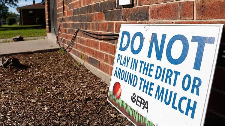A sign from the Environmental Protection Agency is posted in front of West Calumet Housing Complex houses at East Chicago, Ind. - AP Photo/Tae-Gyun Kim
