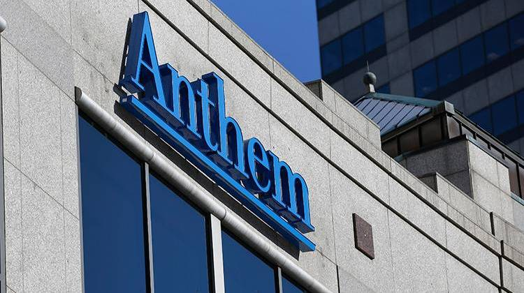 FILE - In this Thursday, Feb. 5, 2015, file photo, the Anthem logo hangs at the health insurer's corporate headquarters in Indianapolis. Anthem beat Wall Street expectations, Wednesday, Oct. 31, 2018, and hiked its 2018 forecast again as the Blue Cross-Blue Shield insurer added more Medicare customers and continued to clamp down its biggest expense, benefit payouts, in the third quarter. - AP Photo/Michael Conroy, File