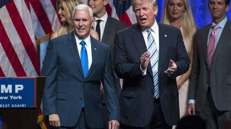 Republican presidential candidate Donald Trump, right, introduces Gov. Mike Pence, R-Ind., during a campaign event to announce Pence as the vice presidential running mate on, Saturday, July 16, 2016 - AP Photo/Evan Vucci