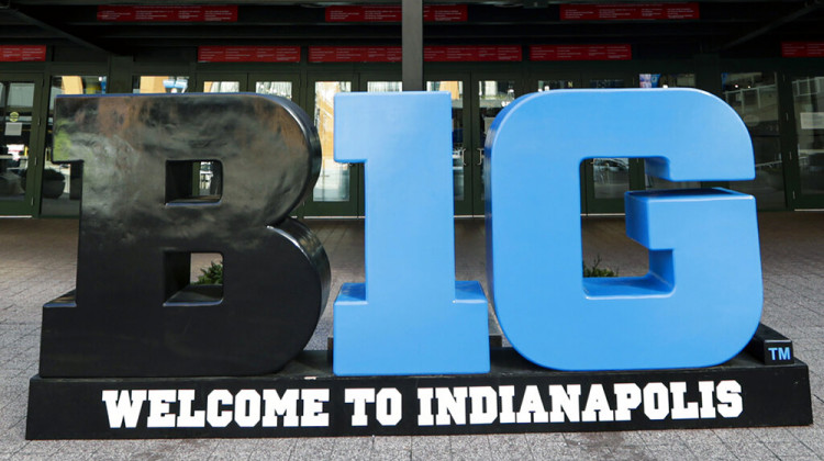 FILE - Big Ten signage is shown outside The Bankers Life Fieldhouse in Indianapolis, in this March 12, 2020, file photo. Big Ten officials have decided to move next month's men's basketball tournament from Chicago to Indianapolis. Games will be played March 10-14 at Lucas Oil Stadium, which also will be the site of this year's Final Four.  - AP Photo/Michael Conroy, File