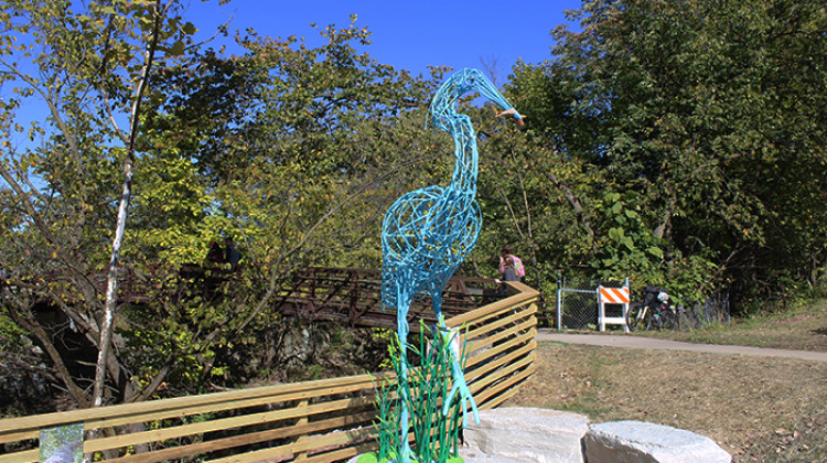 A new sculpture of a blue heron will greet passersby as they cross the Spruce Street bridge near Pleasant Run creek. - Erica Irish/WFYI