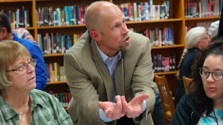 Charlie Schlegel talks to a group during a community meeting about the future of Emmerich Manual and Thomas Carr Howe high schools on Oct. 29, 2018, at Manual school library. - Eric Weddle/WFYI News