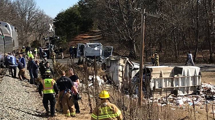 This photo provided by Rep. Greg Walden, R-Oregon, shows a crash site near Crozet, Va., Wednesday, Jan. 31, 2018. A chartered train carrying dozens of GOP lawmakers to a Republican retreat in West Virginia struck a garbage truck south of Charlottesville, Virginia on Wednesday, lawmakers said. - Rep. Greg Walden via AP
