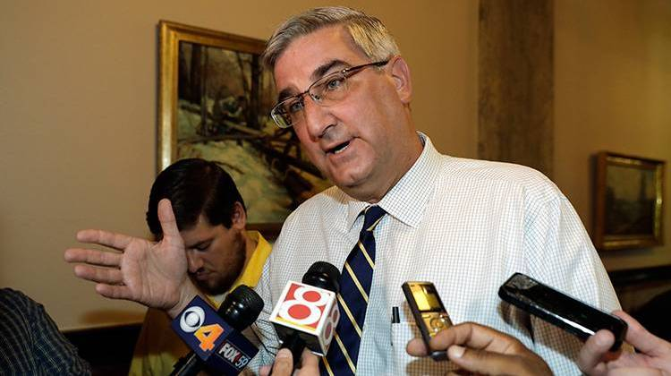 Indiana Lt. Gov. Eric Holcomb responds to questions after carrying paperwork into the Indiana Secretary of State's office in Indianapolis. Friday, July 15, 2016, to remove his name from the ballot for re-election.  - AP Photo/Darron Cummings