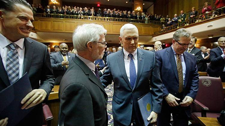 Indiana Gov. Mike Pence, second from right, walks to the podium to deliver his State of the State address to a joint session of the legislature at the Statehouse. - AP Photo/Darron Cummings