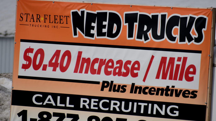 A sign from a trucking company in Nappanee, Indiana, recruits truckers. In some industries, like trucking, worker shortages were exacerbated by the pandemic. - Justin Hicks/IPB News