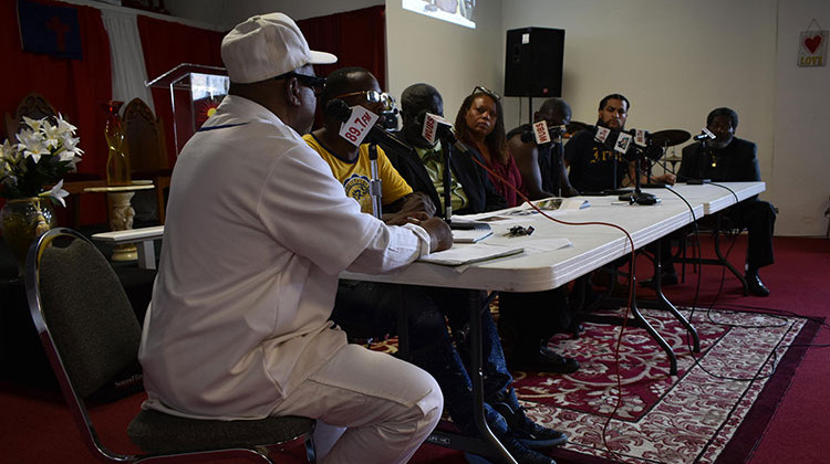 Family members of Eric Logan, city council members, and others sit on a panel at a radio station to discuss the investigation of Logan's death.  - Justin Hicks/IPB News
