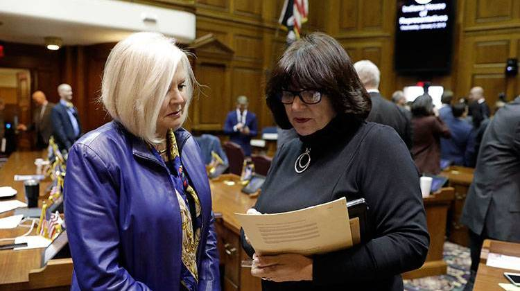 State Rep. Linda Lawson, right, D-Hammond, talks with state Rep. Terri Austin (D-Anderson) following the opening day of the General Assembly session at the Statehouse, Wednesday, Jan. 3, 2018, in Indianapolis. - AP Photo/Darron Cummings
