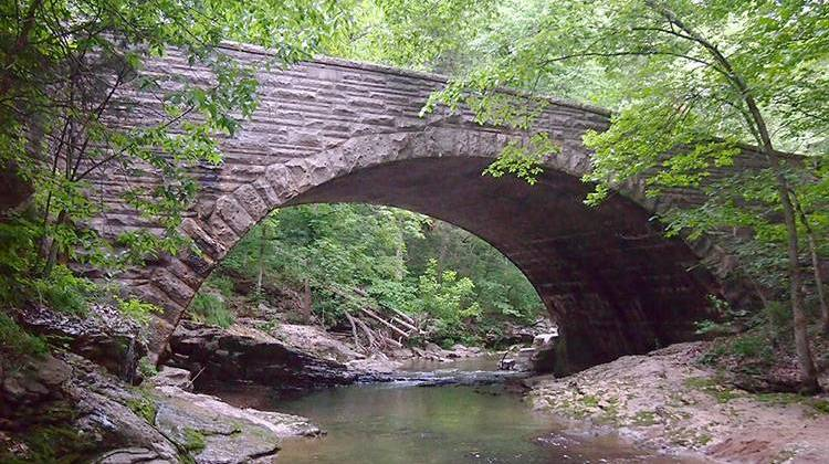 A bridge over McCormick's Creek in McCormick's Creek State Park, which was established in 1916.   - McGhiever, CC-BY-SA-3.0
