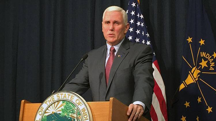 Gov. Mike Pence says he enthusiastically supports the local road funding plan approved by lawmakers. - file photo