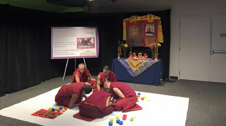 The monks of Tashi Kylil monastery are creating a peace sand mandala at the Children's Museum of Indianapolis. - The Children's Museum