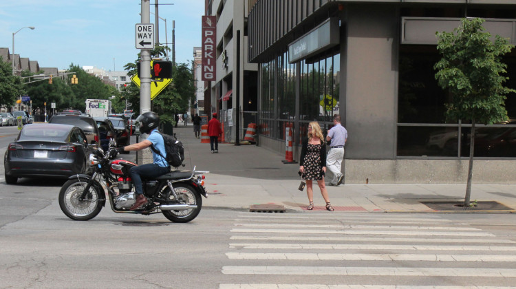 A motorcyclist drives in downtown Indianapolis. - Lauren Bavis/Side Effects Public Media