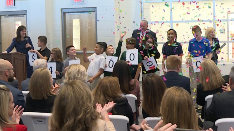 Students helped announce how much funding the grant award included, at a school in the Perry Township district Tuesday. - Jeanie Lindsay/IPB News