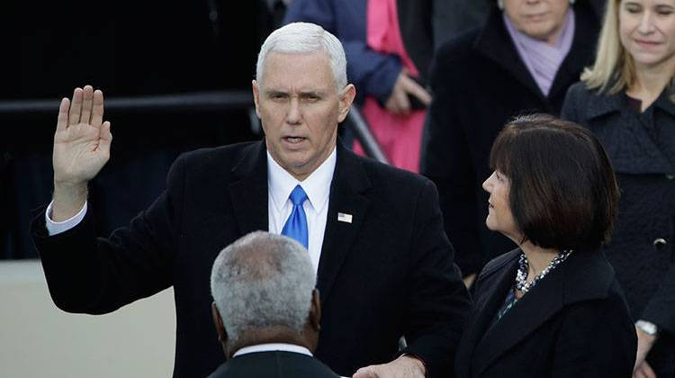 Vice President Mike Pence takes his oatch of office during the 58th Presidential Inauguration at the U.S. Capitol in Washington, Friday, Jan. 20, 2017. At his right is his wife Karen. -  AP Photo/Matt Rourke