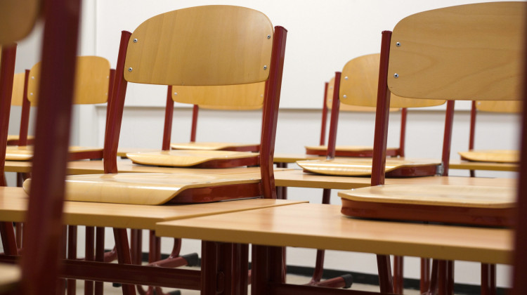 Empty chairs in a classroom.  - Pexels