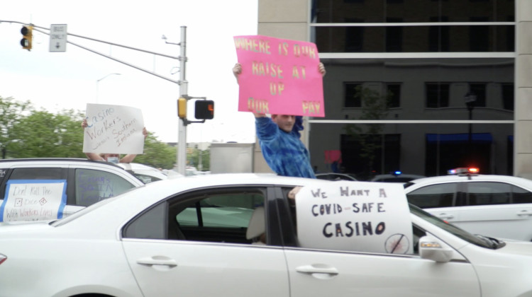 Casino workers hold signs from their cars in downtown Indianapolis. - Alan Mbathi/IPB News