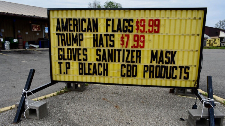 A store in Liberty, Indiana, advertises selling American flags, Trump hats and coronavirus cleaning supplies.  - Justin Hicks/IPB News