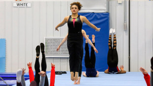 Athletes Warily Embrace Progress As USA Gymnastics Evolves