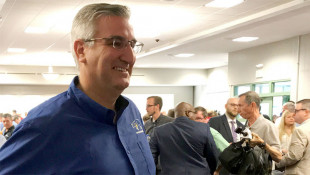 Holcomb Shrugs Off Political Threat Over Hate Crimes Bill Support
