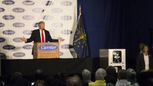 Then-President-elect Donald Trump addresses workers at the Indianapolis Carrier factory last December. - Drew Daudelin/WFYI