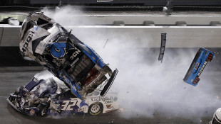 Ryan Newman (6) goes airborne after crashing into Corey LaJoie (32) during the NASCAR Daytona 500 auto race Monday, Feb. 17, 2020, at Daytona International Speedway in Daytona Beach, Fla. Sunday's running of the race was postponed by rain.  - AP Photo/Chris O'Meara