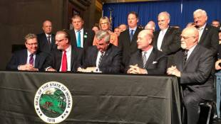 Holcomb Signs Budget, Road Funding Bill