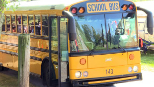 How Do Police Officers Enforce School Bus Safety Laws? They Go Along For The Ride