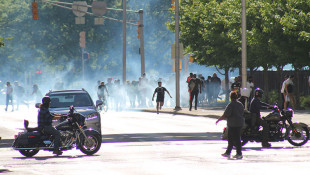 Sunday Night Starts With Tear Gas, But City Streets Go Quiet Under Curfew