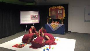 Monks Bring Real-Time Sacred Tradition to Children's Museum Exhibit