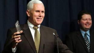 Pence Announces Tax Conference; Receives Award