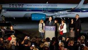Supporters Welcome Pence's Return To Indiana After Election
