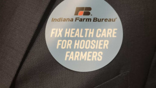 Indiana Farm Bureau members wear stickers to show support for a bill that would allow the organization to offer health benefit plan. - Samantha Horton/IPB News