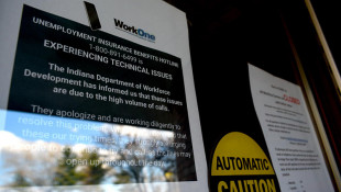 A sign informs visitors that while WorkOne employment offices are closed, the Department of Workforce Development is experiencing technical issues due to high call volumes.  - Justin Hicks/IPB News